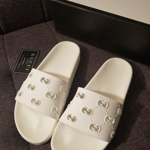 Pre owned White Gucci rubber GG slides, Size 10